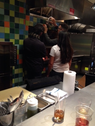 This photo is of Leah and her competition, learning about the wood fired oven in the kitchen. Getting a quick tour of the kitchen was essential!